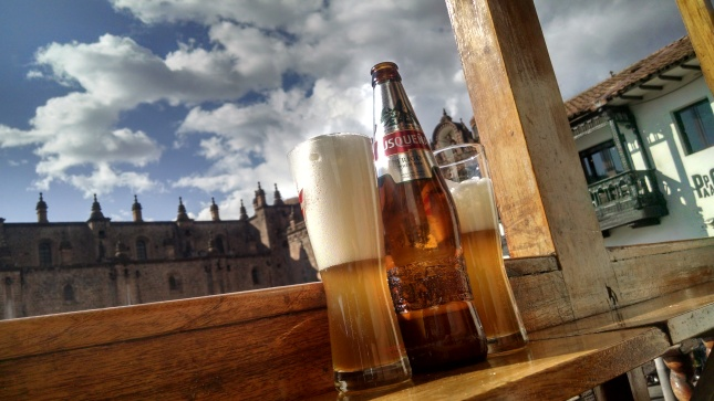 foamy beer with the cathedral in the background